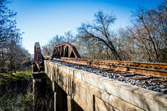 Old Railroad Bridge, Grainger Texas. Old iron railroad bridge crossing the river outside Grainger Texas Stock Photo