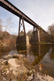 Old railroad bridge over a creek vertical Royalty Free Stock Image