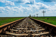 Old Railroad. Close up on a sunny day with bright blue sky Royalty Free Stock Photography