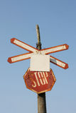 Old railroad crossing. With blue sky background Stock Images