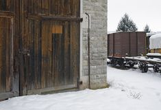 Old railroad depot and railway cars Stock Photography