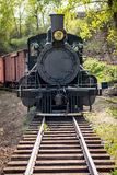 Old railroad engine rolls down the tracks stock photography