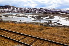 The old railroad, lake and mountains, Norway Royalty Free Stock Images