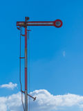 Old railroad signal. And blue sky Stock Photos