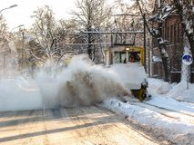 Old railroad snow cleaning tram in action. Liepaja, Latvia. Retro snow cleaning streetcar in action Royalty Free Stock Photo