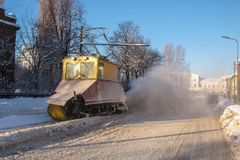 Old railroad snow cleaning tram in action. Liepaja, Latvia. Retro snow cleaning streetcar in action Royalty Free Stock Images