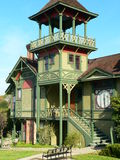 Old railroad station. Old railway station San Diego oldtown, three stories, restored and freshly painted green. Tower with large balcony. Bench in the foreground Royalty Free Stock Images