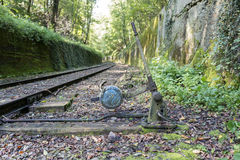 Old railroad track switch with train background Royalty Free Stock Photography