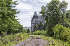 Old railroad tracks with building Royalty Free Stock Photos
