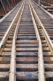 Old railroad tracks on metal bridge Stock Photography