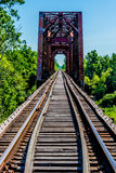 Old Railroad Trestle with an Old Iconic Iron Truss Bridge Royalty Free Stock Photography