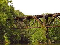 Old Railroad Trestle. A photograph of an old railroad trestle spanning a shallow river Royalty Free Stock Image