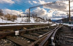 Old railroad in winter mountain. On a cloudy day. transportation background Royalty Free Stock Image
