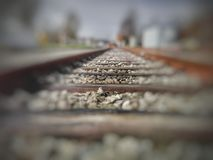 Railroad sleepers in selective focus. Old railroad wooden sleepers in selective focus, from low angle ground level view Stock Photos