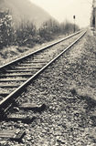 Old Rails in Mountains. Closeup view on train rails in mountains Royalty Free Stock Photo