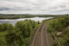 Old rails by the Tuloma river in tundra Stock Photography