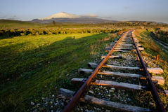 Old railway abandoned and volcano Etna Royalty Free Stock Image