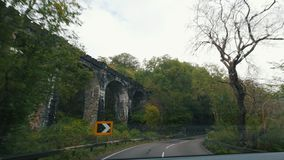 Old railway aqueduct in Scottish highland - highway in Scotland stock video footage