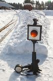 Old railway arrow with a lantern in snow Stock Photo