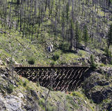 Old railway bridge. An old wooden rail bridge bends in fores mountains in Kettle Valley, BC, Canada Stock Image