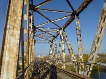Old railway bridge in the industrial area stock image