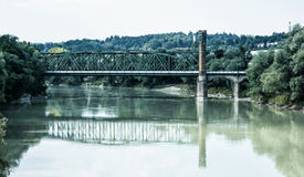 Old railway bridge is mirrored in river, Passau, Germany Stock Image