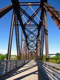 Old Railway Bridge over the Saint John River at Fredericton, New Brunswick. The metal structure of the old railway bridge was converted to serve as a foot and stock photography