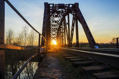 The old railway bridge at sunset Stock Images