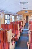 Old railway carriage in red striped seats Royalty Free Stock Photos