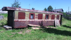 Old railway carriage. Old rusty railway wagon used by the barn Royalty Free Stock Images