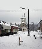 Old railway cars and station. Outdoor shot of old railway cars and station in Southern Germany at winter time Royalty Free Stock Photos