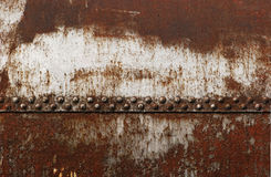 Old railway cistern riveted joint. Old rusty railway cistern riveted joint as background royalty free stock image
