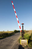 Old railway crossing in the middle of fields Stock Photography