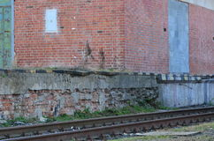An old railway depot with railroad line Royalty Free Stock Photo