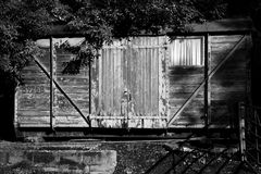 Old railway freight carriage. Used as a shed black and white image stock images