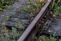 Old railway rails. Connecting railway rails in old technology. royalty free stock photo