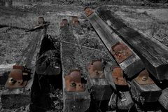 Old railway sleepers in a pile. With selective colour Stock Images