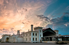 Old railway station with beautiful cloudscape Royalty Free Stock Photo