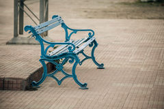 Old railway station chair bench Stock Photo