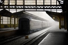Old Railway station with train. Old Railway station indoor view with train and empty platform in Peterburg Russia. Snowy winter day stock image