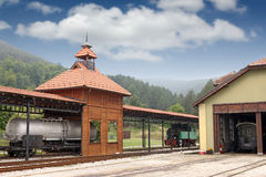 Old railway station with locomotive Stock Photo