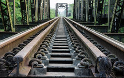 The old railway steel bridge in Thailand Stock Photos