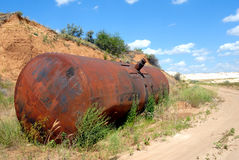 Old railway tank for transportation of mineral oil. The old railway tank worth on the ground Stock Photo