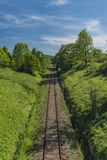 Old railway track in spring sunny day Royalty Free Stock Photo