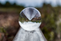 Old railway tracks with glass sphere on them and selective focus.  Royalty Free Stock Images