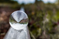Old railway tracks with glass sphere on them and selective focus.  Royalty Free Stock Photography