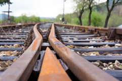 Old railway tracks at a junction Royalty Free Stock Photo