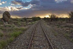 Old railway tracks and stormy sky Stock Photo