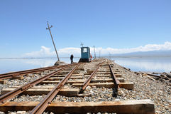 Old railway under blue sky. An old railway go to the central of Chaka saltlake in Qinghai Royalty Free Stock Photo