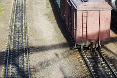 Old railway wagon standing on the railway. The view from the top Royalty Free Stock Photography